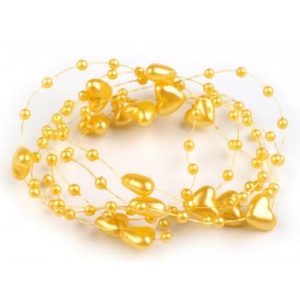 Perełki na żyłce silikonowej z serduszkami Ø10mm długość 130cm - żółte