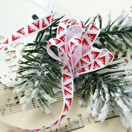White satin ribbon in geometrical red Christmas trees
