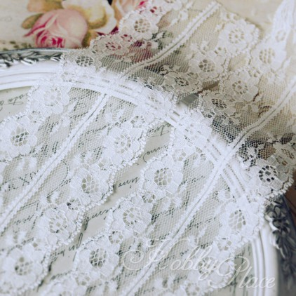 Synthetic lace with a decorative edge - widh 6,5 cm - white - 1 meter